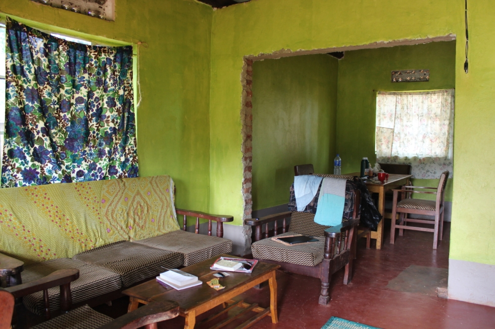 Through front door, sitting area and dining area in back.