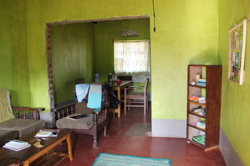 I've always wanted green walls, so citrus green it is! Most of the furniture Naffa let me use, bookcase made locally in village.