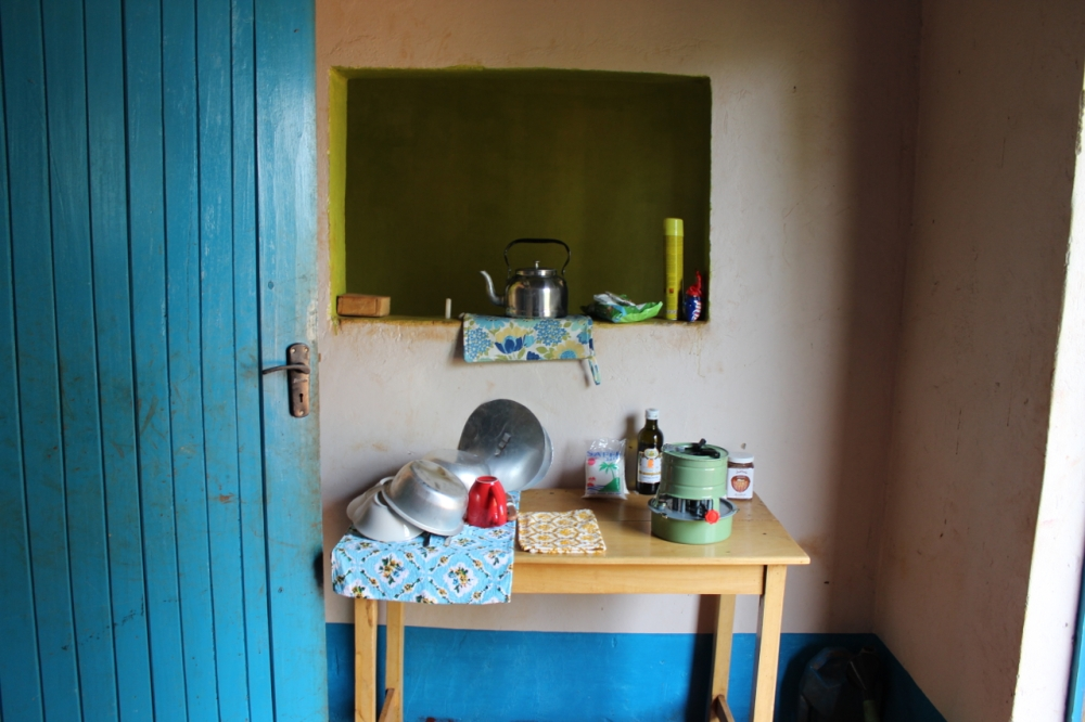 Kitchen w/paraffin stove and a touch from Mum