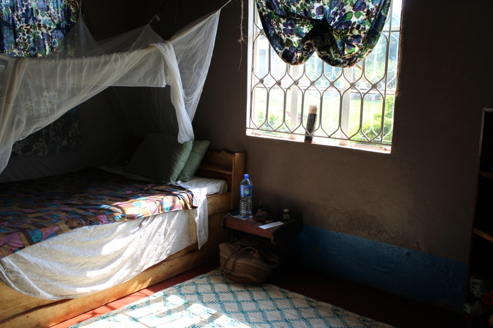 My room, painted walls but blue skirt was already there. In Uganda, they paint skirts to try and hide the red dirt that travels everywhere.